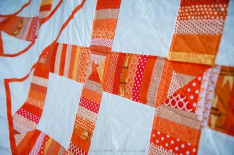 orange scrap quilt